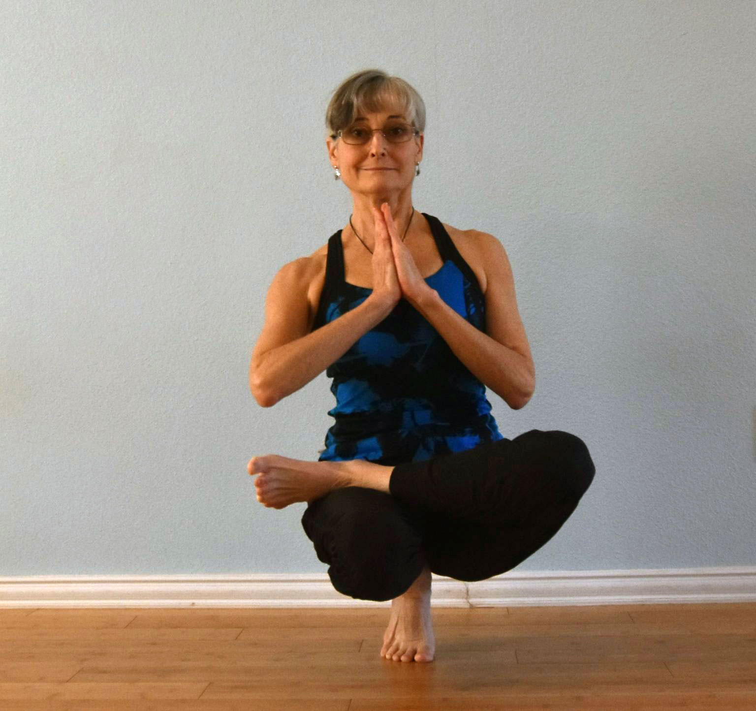 Half Lotus Tip Toe Pose